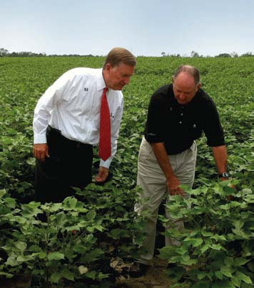 Meredith Allen and Stan McMikle inspect an irrigated field in Georgia